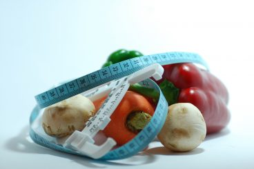 root vegetables with a measuring tape