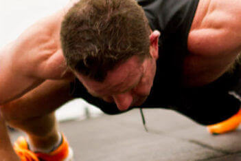 trifusion fitness man performing pushup